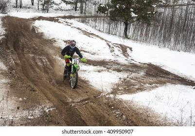KYIV, UKRAINE -  FEBRUARY 15, 2015: Motorcyclist training on a winter race track.