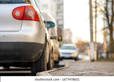 Kyiv, Ukraine - February 16, 2020: Modern cars parked on city street side in residential discrict. Shiny vehicles parked by the curb. Urban transportation infrastructure concept.