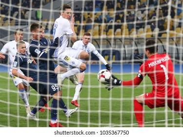 KYIV, UKRAINE - FEBRUARY 18, 2018: Ukrainian Premier League game FC Dynamo Kyiv v Olimpik Donetsk. FC Dynamo Kyiv players (white) score a goal. NSC Olympic stadium in Kyiv