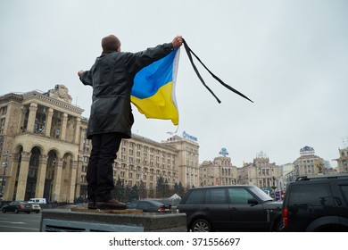 KYIV, UKRAINE - FEBRUARY 20, 2015: Man commemorates Heavenly Hundred -  anti-government protesters who were ago during the bloodiest part and culmination of the EuroMaidan Revolution.