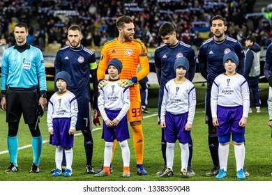 Kyiv, Ukraine - February 22, 2019: Olympiakos FC players before the start of UEFA Europa League match against Dynamo Kyiv at NSC Olympic stadium.