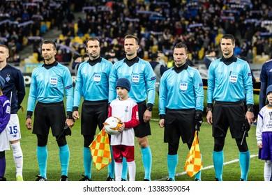 Kyiv, Ukraine - February 22, 2019: Main referees team with head Ivan Kruzliak at the UEFA Europa League match between Dynamo Kyiv vs Olympiakos FC at NSC Olympic stadium.