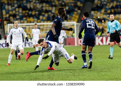 Kyiv, Ukraine - February 22, 2019: Benjamin Verbic of Dynamo Kyiv fighting for the ball with Pappe Cisse of Olympiakos during UEFA Europa League match at NSC Olimpiyskiy stadium.