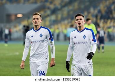 Kyiv, Ukraine - February 22, 2019: Benjamin Verbic and Tomasz Kedziora of Dynamo Kyiv at UEFA Europa League match against Olympiakos FC at NSC Olympic stadium.