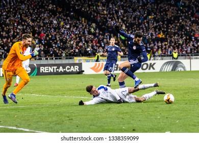 Kyiv, Ukraine - February 22, 2019: Players in action during UEFA Europe League match Dynamo Kyiv – Olympiakos FC at NSC Olympic stadium.