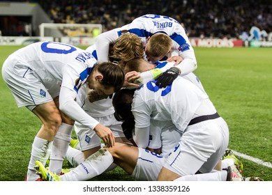 Kyiv, Ukraine - February 22, 2019: Dynamo Kyiv players celebrates scoring a goal in UEFA Europa League match against Olympiakos FC at NSC Olympic stadium.