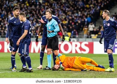 Kyiv, Ukraine - February 22, 2019: Olympiakos FC players in action at UEFA Europa League match against Dynamo Kyiv at NSC Olympic stadium.