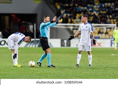 Kyiv, Ukraine - February 22, 2019: Benjamin Verbic of Dynamo Kyiv gets yellow card in UEFA Europa League match against Olympiakos FC at NSC Olympic stadium.