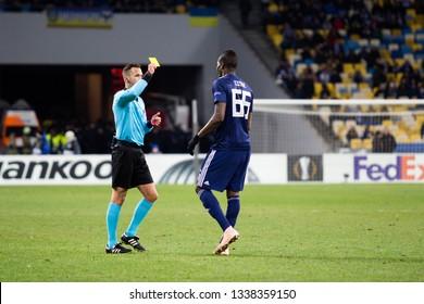 Kyiv, Ukraine - February 22, 2019: Papa Abou Cisse gets yellow card in UEFA Europa League match against Dynamo Kyiv at NSC Olympic stadium.