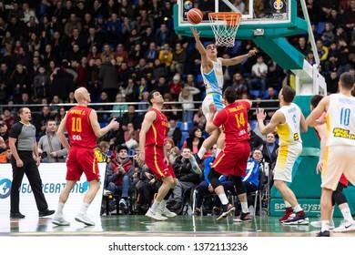 KYIV, UKRAINE - FEBRUARY 22, 2019: Vyacheslav Bobrov put up ball on the rebound play. FIBA World Cup 2019 European Qualifiers game Ukraine v Montenegro
