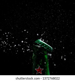 KYIV, UKRAINE - FEBRUARY 23, 2019: Single Bottle of Heineken Premium Lager Beer against black background. Heineken is a premium brand lager beer brewed in Holland by the Heineken Brewing Company.
