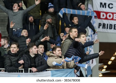 KYIV, UKRAINE - FEBRUARY 24, 2016: FC Manchester City football team supporters show their support during the game between FC Dynamo Kyiv and FC Manchester City at NSC Olimpiyskyi stadium