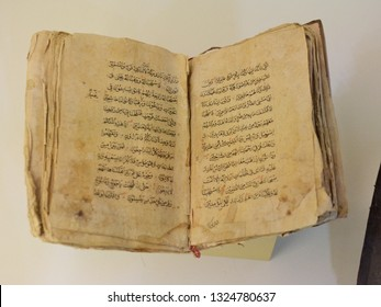 """KYIV, UKRAINE - FEBRUARY 26, 2019: Ancient Crimean Tatar Quran during the forum """"Amazing Stories of Crimea"""" devoted to the 5th anniversary of the military occupation of the Crimea by Russia"""