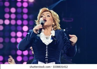 KYIV, UKRAINE - FEBRUARY 27, 2018: Ukrainian singer and former People's Deputy of Ukraine  Oksana Bilozir performs live on stage during a concert at Palac â??Ukraineâ? in Kyiv, Ukraine