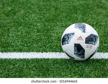 KYIV, UKRAINE — February 4, 2018:  Adidas Telstar 18 Top Replique  lies on the wet field.