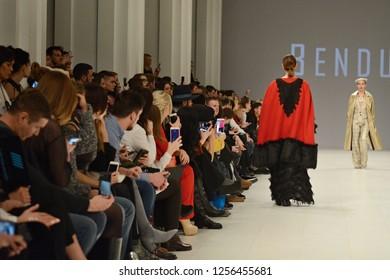KYIV, UKRAINE - FEBRUARY 5, 2018: Model presents a creation by designer Bendus during Fashion Show as part of Ukrainian Fashion Week FW18-19 at Mystetskyi Arsenal in Kyiv, Ukraine