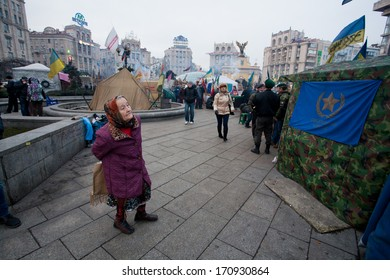 KYIV, UKRAINE - JAN 7: Elderly woman looks at the camp protesters anti-government revolution on January 7, 2013. Population of 2,847,200 people making Kiev at least 8-th largest city in Europe.