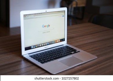 KYIV, UKRAINE - JANUARY 10, 2018: Modern Apple Macbook Air Silver with Google search page on screen