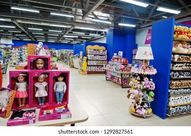 Kyiv, Ukraine - January 16, 2018: Customers shop for toys. Department for girls, dolls in boxes.