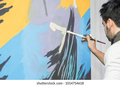 KYIV, UKRAINE - January 18, 2018: talented artist, finalist of the show Ukraine has a talent, presented to Alexander Usik his portrait painted in 6 minutes.