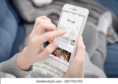 Kyiv, Ukraine - January 24, 2018: Woman using Google app on Apple iPhone 8 plus at home. Google it is the most-used search engine on the World , handling more than three billion searches each day