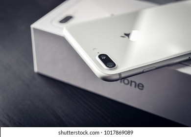 Kyiv, Ukraine - January 24, 2018:Unpacked new Apple iPhone 8 Plus Silver  on black wooden background. IPhone 8 Plus was created and developed by the Apple inc.