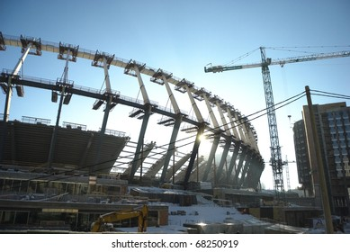 KYIV, UKRAINE - JANUARY 4: Kiev will host UEFA EURO 2012 in two years. The construction works of Kyiv's Olympic stadium are hold even in a frosty weather.  January 4, 2010, Kyiv, Ukraine