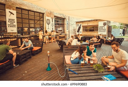 KYIV, UKRAINE - JUL 23: Young people meeting for drink in pop-up restaurant during outdoor Street Food Festival on July 23, 2016. Kiev is the 8th most populous city in Europe