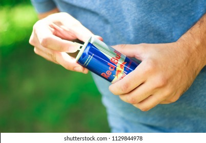 KYIV, UKRAINE - JULY 04, 2018:Red Bull is an energy drink sold by Austrian company Red Bull GmbH, created in 1987. Red Bull is the most popular energy drink in the world.