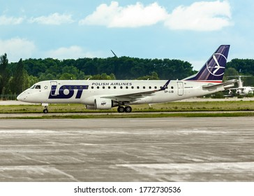 KYIV, UKRAINE - JULY 08, 2020: LOT Polish Airlines Embraer 170-200STD standing at the airport