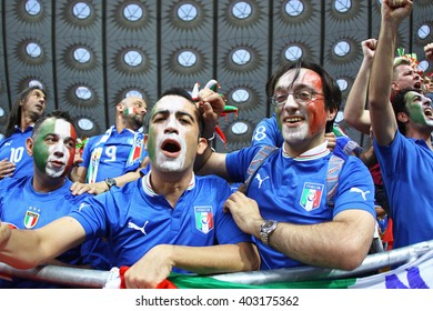 KYIV, UKRAINE - JULY 1, 2012: Italy national football team supporters show their support during UEFA EURO 2012 Championship final game at NSC Olympic stadium in Kyiv, Ukraine