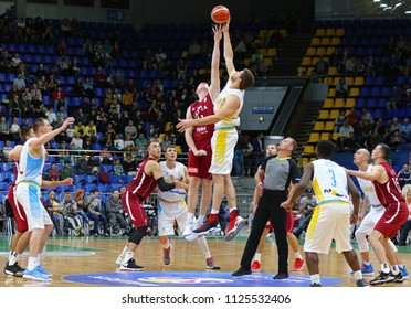 KYIV, UKRAINE - JULY 1, 2018: Jump ball (opening tip) starts the FIBA World Cup 2019 European Qualifiers game Ukraine (in White) v Latvia (in Red) at Palace of Sports in Kyiv. Latvia won 93-71