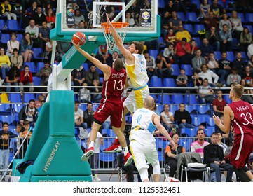 KYIV, UKRAINE - JULY 1, 2018: Janis Strelnieks of Latvia (L) fights for a ball with Viacheslav Kravtsov of Ukraine during their FIBA World Cup 2019 European Qualifiers game at Palace of Sports