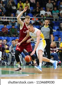 KYIV, UKRAINE - JULY 1, 2018: Davis Bertans of Latvia (L) and Igor Zaytsev of Ukraine in action during their FIBA World Cup 2019 European Qualifiers game at Palace of Sports. Latvia won 93-71
