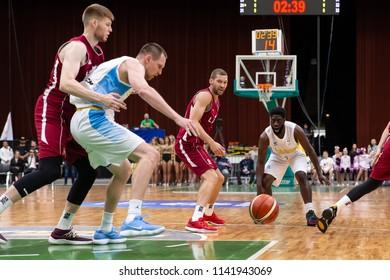 KYIV, UKRAINE - JULY 1, 2018: Eugene Jeter bad pass into the paint marked in defense by Janis Strelnieks. FIBA World Cup 2019 European Qualifiers match Ukraine-Latvia