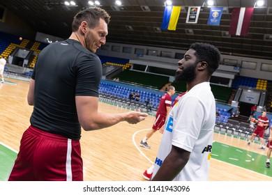 KYIV, UKRAINE - JULY 1, 2018: Janis Blums and Eugene Jeter portraits talking to each other. FIBA World Cup 2019 European Qualifiers match Ukraine-Latvia