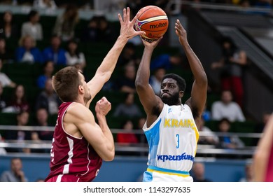 KYIV, UKRAINE - JULY 1, 2018: Spectacular jump shot by Eugene Jeter marked by Ojars Silins in defense trying to block the shot. FIBA World Cup 2019 European Qualifiers match Ukraine-Latvia