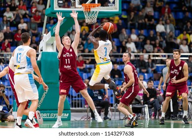 KYIV, UKRAINE - JULY 1, 2018: Spectacular jump shot by Eugene Jeter marked by Rolands Smits in defense. FIBA World Cup 2019 European Qualifiers match Ukraine-Latvia