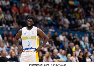 KYIV, UKRAINE - JULY 1, 2018: Eugene Jeter negative space close-up portrait with the stands and crowd on background. FIBA World Cup 2019 European Qualifiers match Ukraine-Latvia