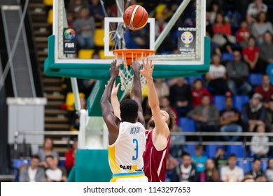 KYIV, UKRAINE - JULY 1, 2018: Eugene Jeter with a tough Michael Jordan style buzzer beater jump shot from the mid range. FIBA World Cup 2019 European Qualifiers match Ukraine-Latvia