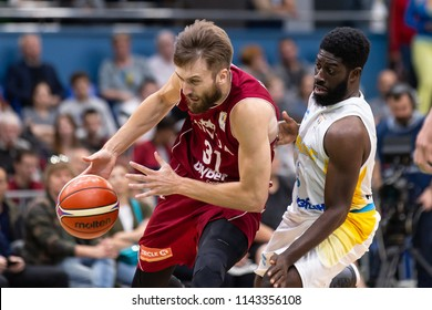 KYIV, UKRAINE - JULY 1, 2018: Zanis Peiners runs, dribbles go through from personal defense by Eugene Jeter. FIBA World Cup 2019 European Qualifiers match Ukraine-Latvia