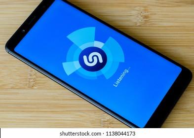Kyiv, Ukraine- July 12, 2018: Shazam logo on screen Xiaomi Redmi Note 5.
