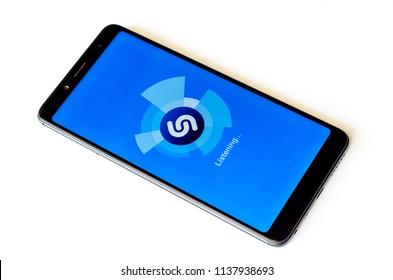Kyiv, Ukraine- July 13, 2018: Shazam logo on screen Xiaomi Redmi Note 5.
