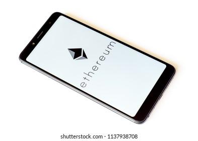 Kyiv, Ukraine- July 13, 2018: Ethereum logo on screen Xiaomi Redmi Note 5.