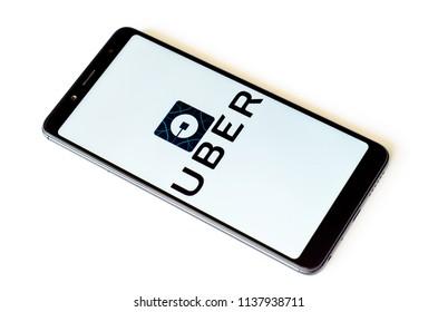 Kyiv, Ukraine- July 13, 2018: UBER logo on screen Xiaomi Redmi Note 5.
