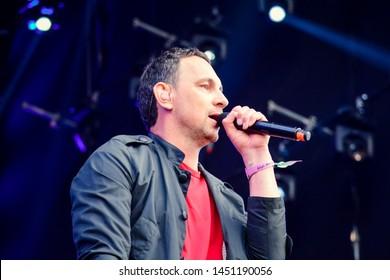 KYIV, UKRAINE - JULY 14, 2019: Valeriy Kharchyshyn soloist of the group Druha Rika during Music Festival Atlas Weekend 2019