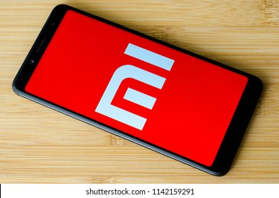 Kyiv, Ukraine- July 15, 2018: Xiaomi logo on screen Xiaomi Redmi Note 5.