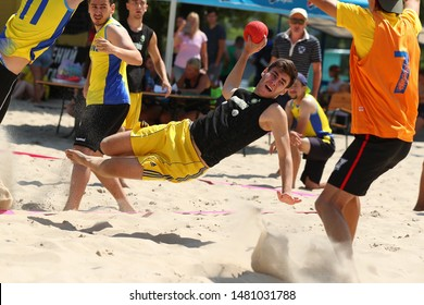 KYIV, UKRAINE - JULY 19, 2019: Beach handball Ukrainian Cup 2019 Tournament. Amazing spectacular beautiful moments. Young talented players. Sports, physical activity. Training, sports for children.