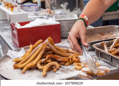 Kyiv, Ukraine - July 23, 2017: Sale of churros on the street. Churros - national Spanish dessert