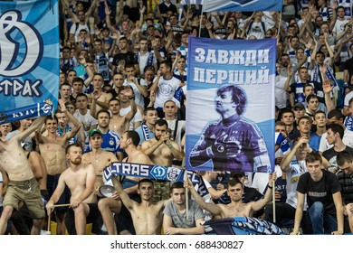 Kyiv, Ukraine - July 26, 2017: Ultras of Dynamo Kyiv in the stands with attributes during the match against FC Young Boys at UEFA Champions League game at NSC Olimpiyskiy stadium.